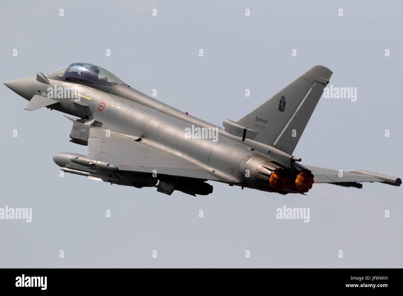 FLORENNES, BELGIUM - JUN 15, 2017: Italian Air Force Eurofighter Typhoon fighter jet take off flyby. Stock Photo