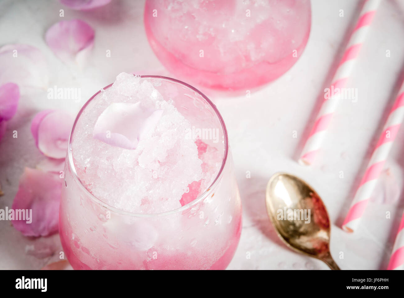 Summer refreshing desserts. Vegan diet food. Ice cream frozen rose, froze, with rose petals and rose wine. On a Stock Photo