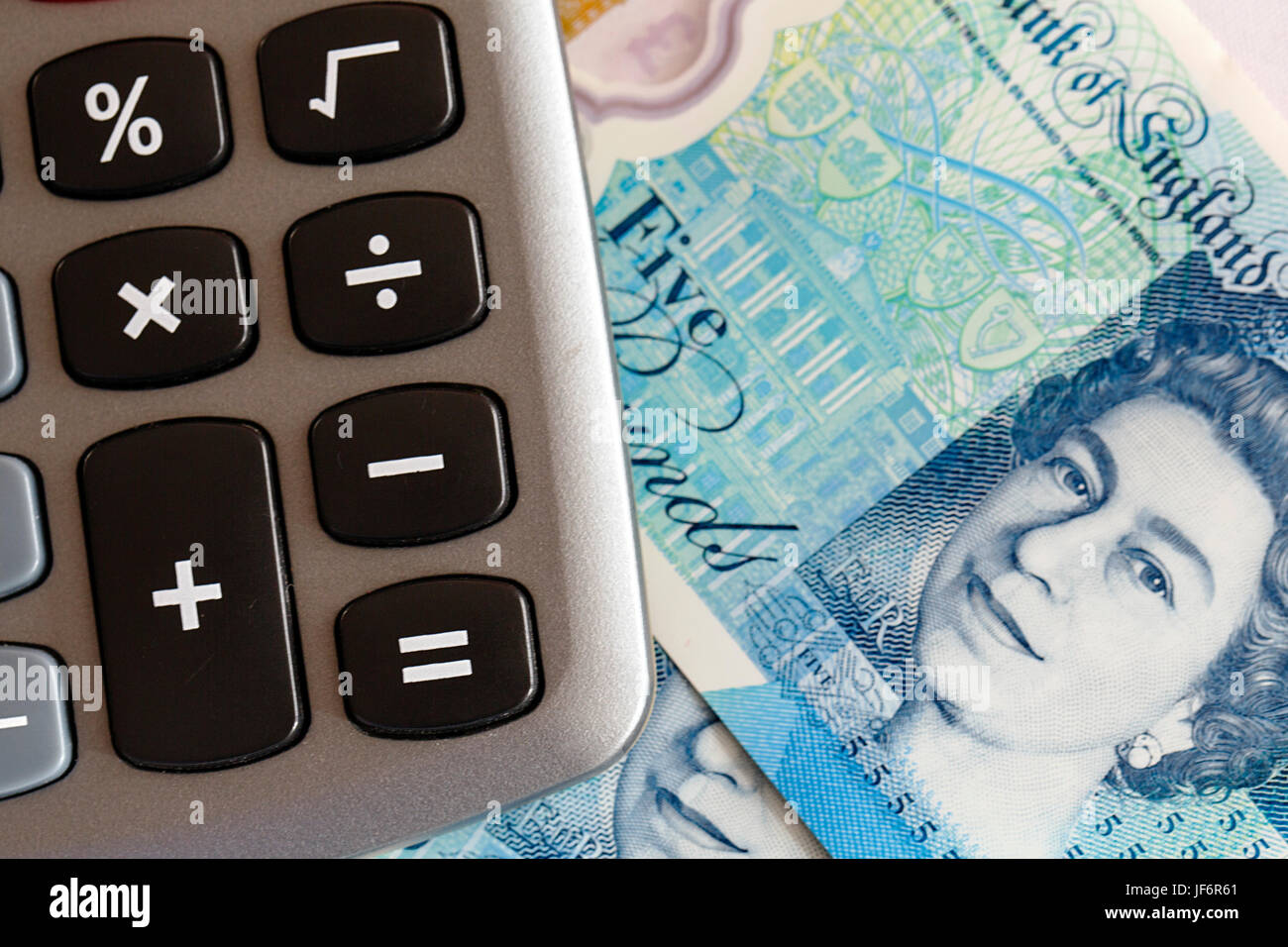 New Polymer Five Pouind Note with a Calculator - UK - Stock Image
