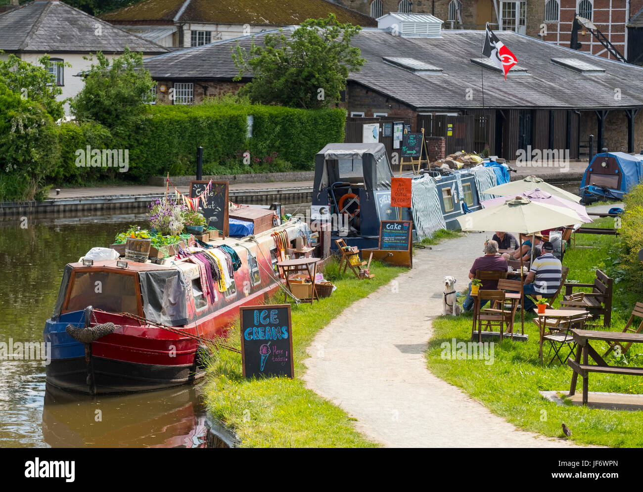 Narrow boats selling ice cream and produce on the Llangollen Canal at Ellesmere, Shropshire, England, UK - Stock Image