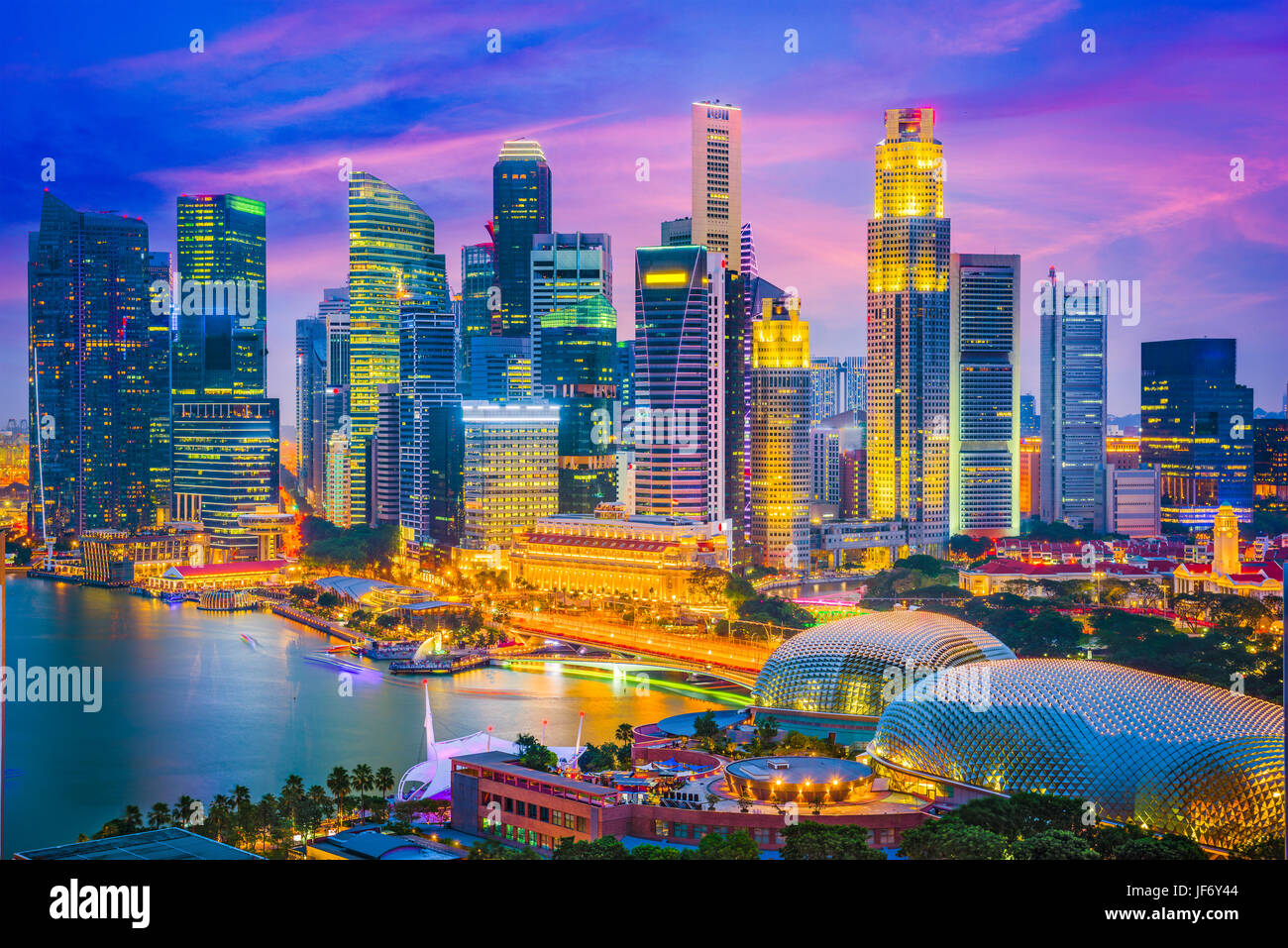 Singapore city skyline at twilight. - Stock Image