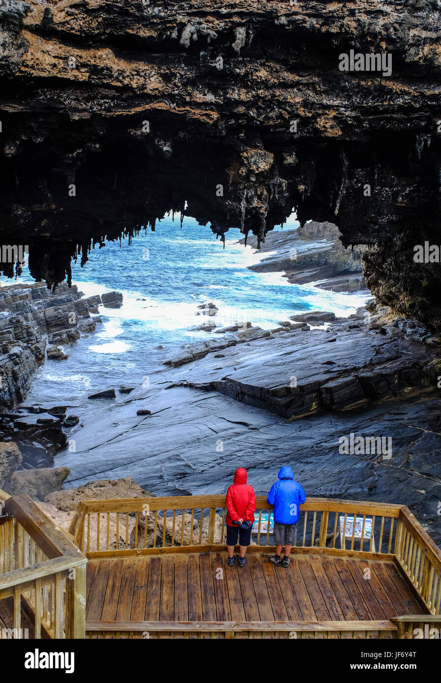 Tourists visit the cave of Admirals Arch on Kangaroo Island, South Australia. The island lies in the state of South - Stock Image