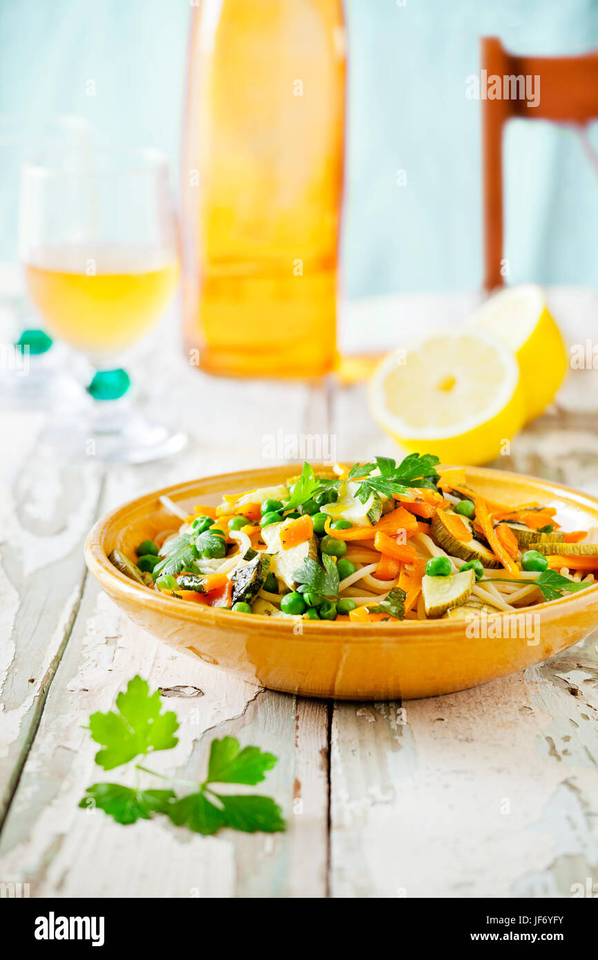 Plate of pasta with some grilled zucchini and carrots with herbs - Stock Image