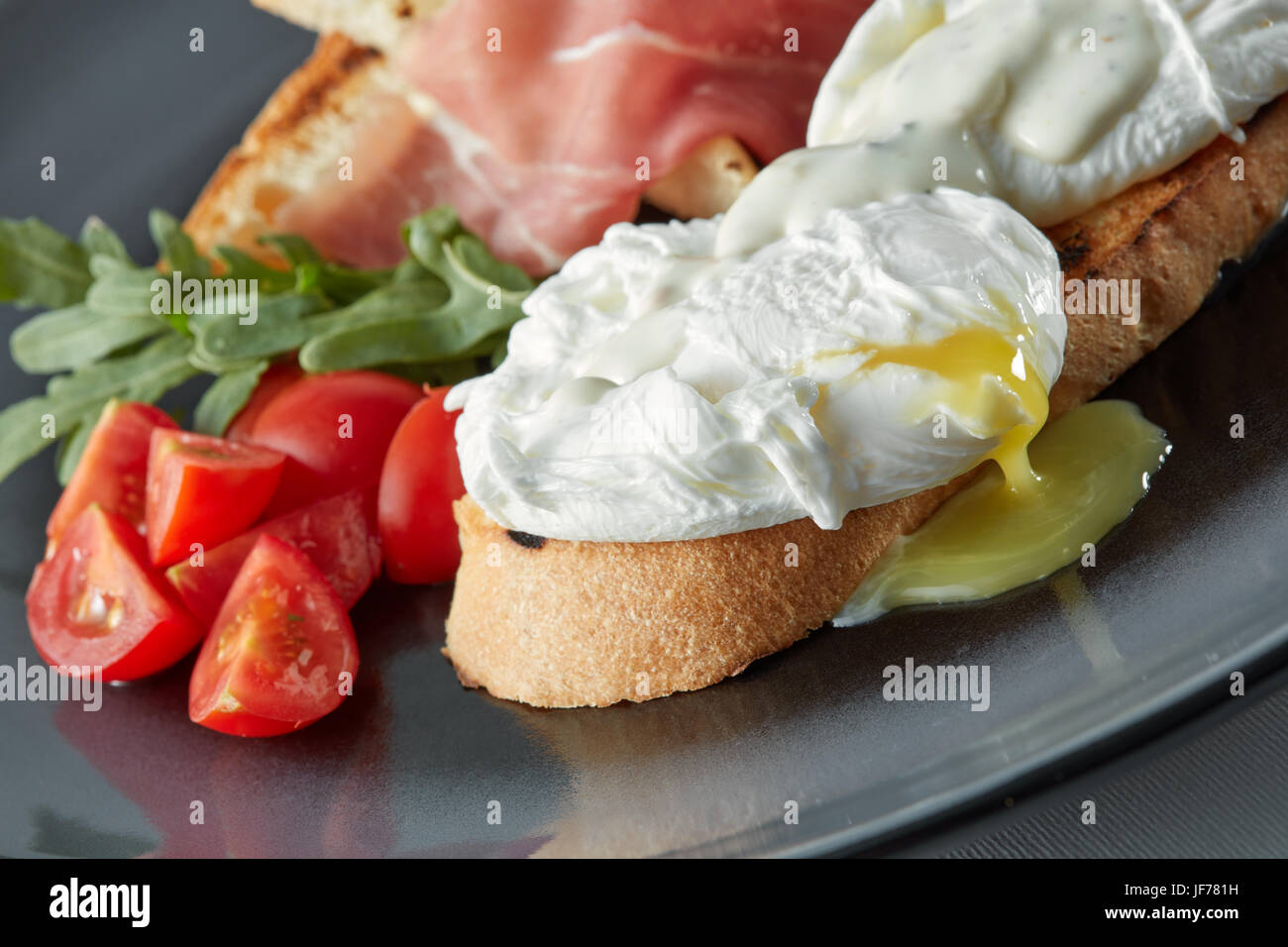 Eggs Benedict on toasted muffins - Stock Image