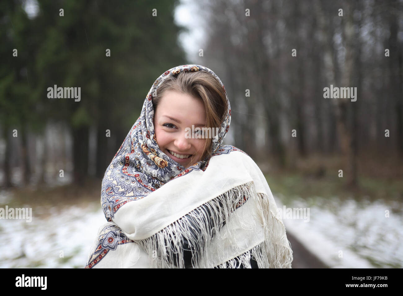 b575261493d9b Beautiful young russian girl wearing traditional headscarf on forest  background - Stock Image