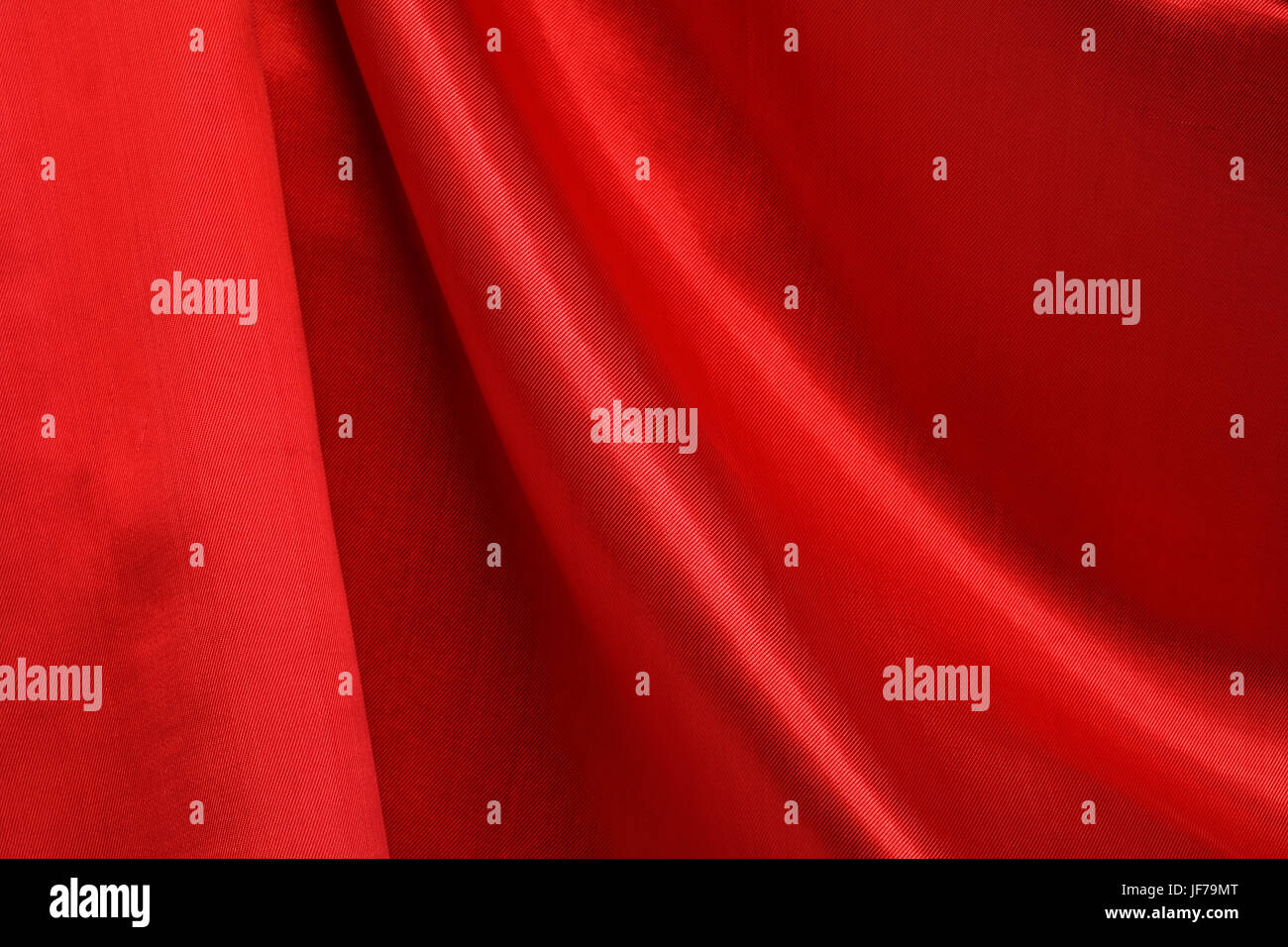 Closeup of red silk curtain. Nice background - Stock Image