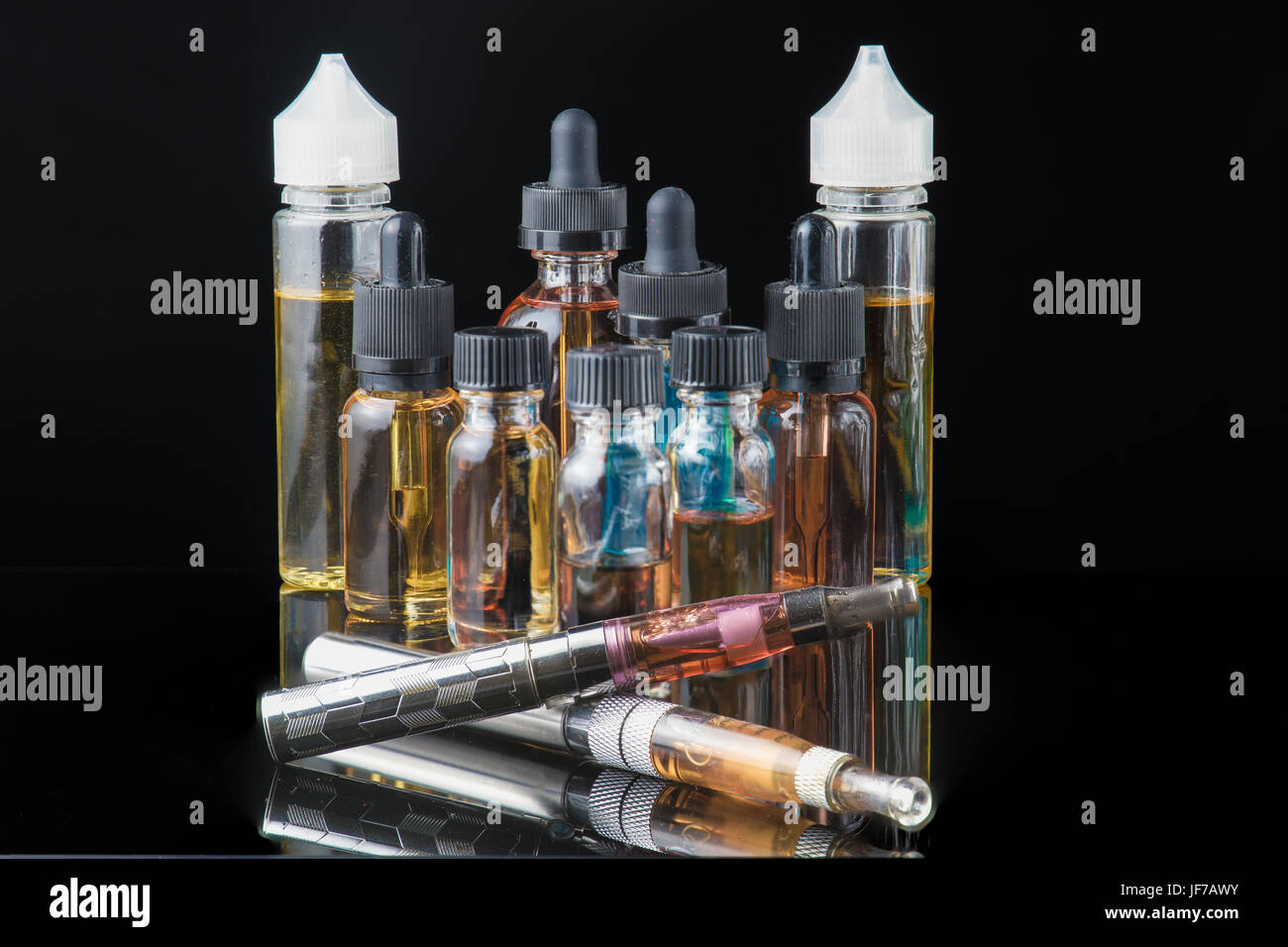 Collection of electronic cigarette equipment with smoke - Stock Image
