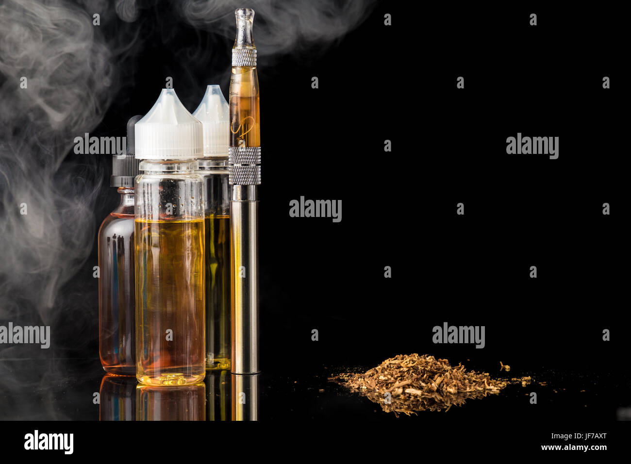 Electronic cigarette with bottles and grinded tobacco leaves Stock Photo