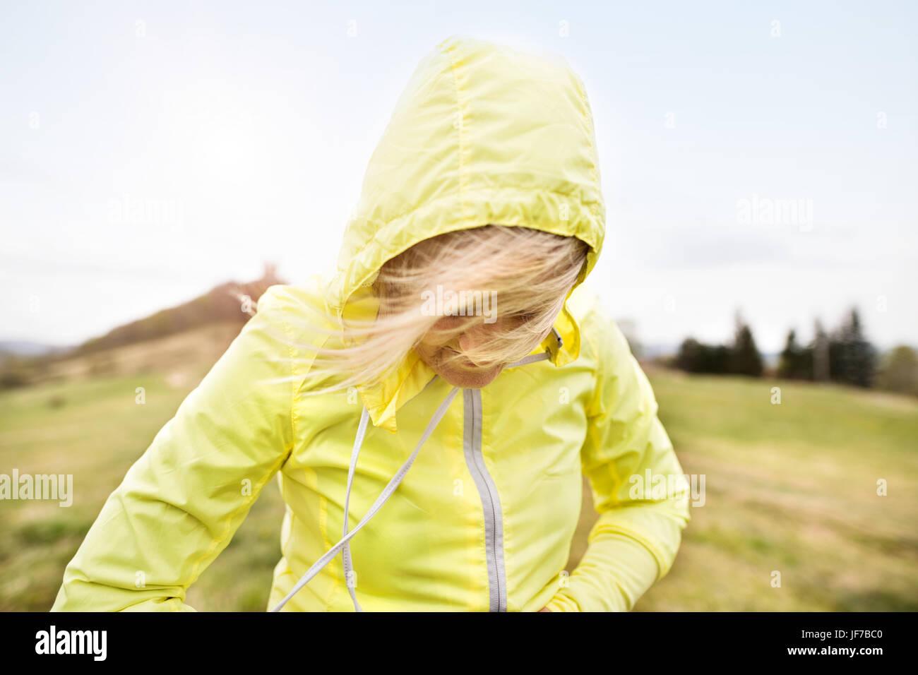 Unrecognizable senior runner outside on green hills. - Stock Image