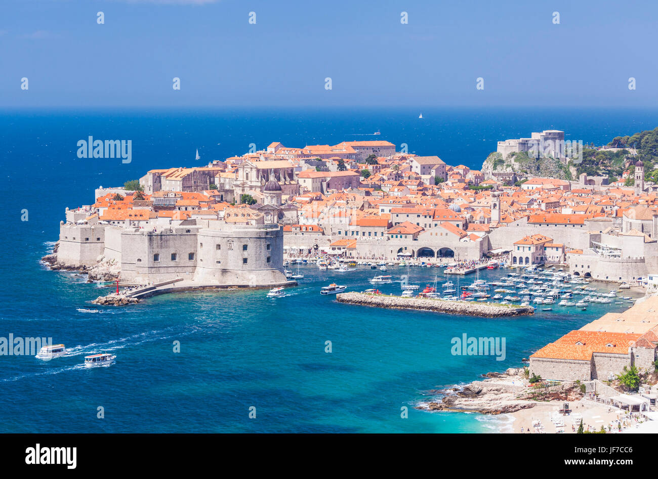 Croatia Dubrovnik Croatia Dalmatian coast view of Dubrovnik old Town city walls old port and harbour with boats - Stock Image