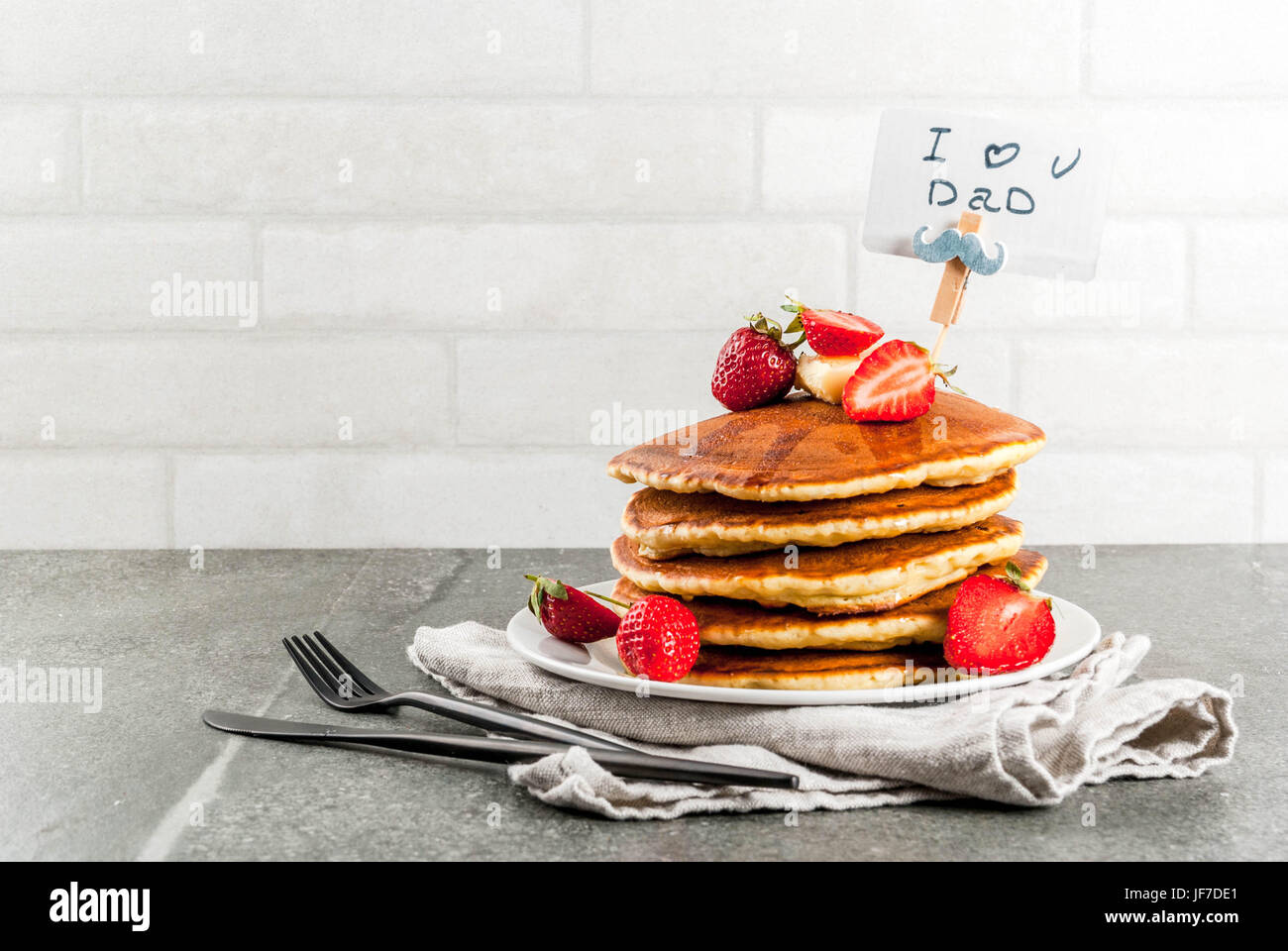 Celebrating Father's Day. Breakfast. The idea for hearty and delicious holiday breakfast: pancakes with butter, - Stock Image
