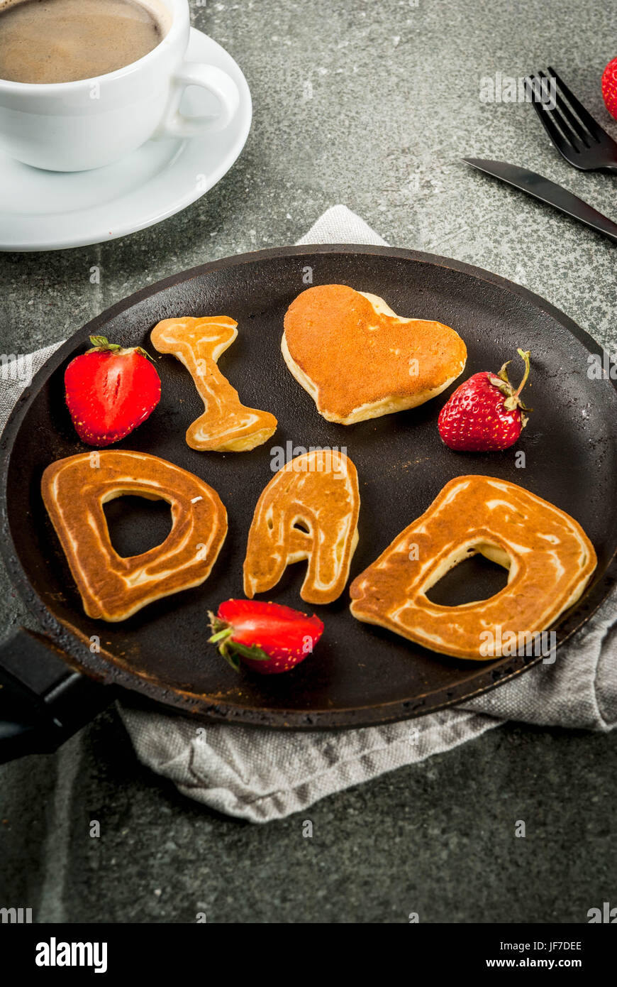 Celebrating Father's Day. Breakfast. The idea for a hearty and delicious breakfast: pancakes in form of congratulations - Stock Image