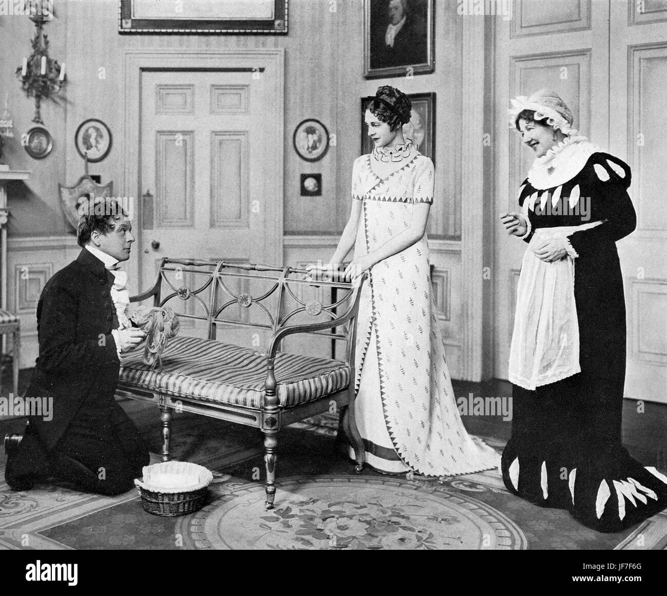 'Pride and Prejudice': Mr Collins (Lyonel Watts) picks up Mrs Bennet's (Barbara Everest) wool and tries - Stock Image