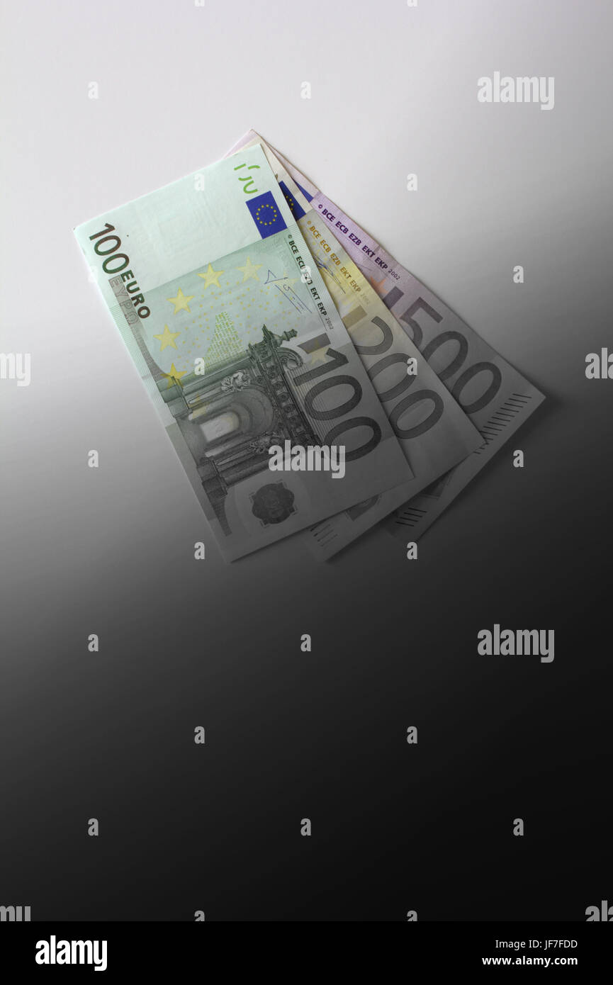 Euro banknotes disappearing into black, unregulated capital market concept, copy space - Stock Image