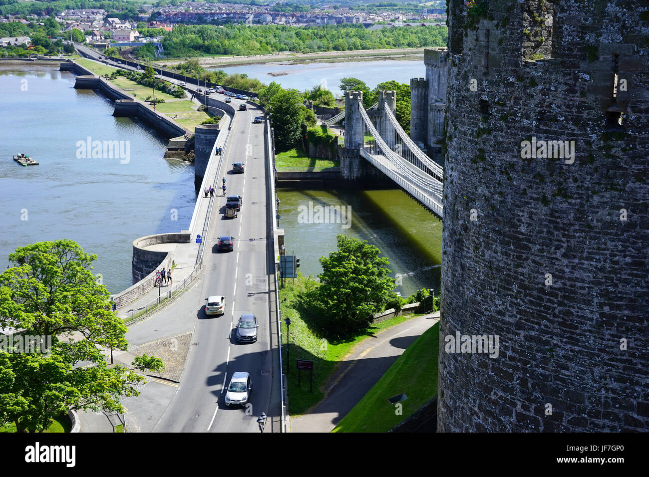 View from Conwy Castle showing the A55 trunk road and also the original which went over Thomas Telfords suspension - Stock Image