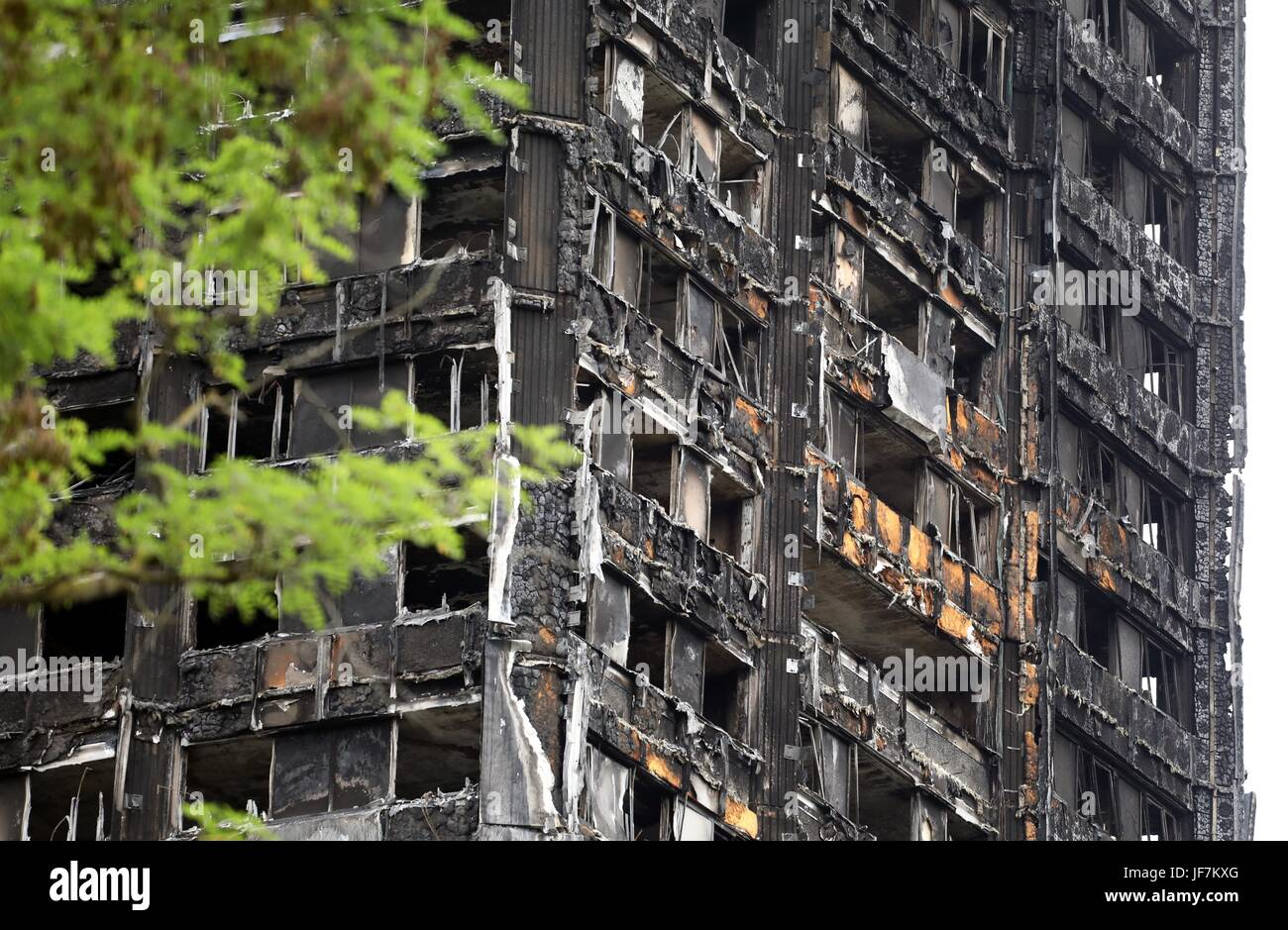 Grenfell Tower burnt out shell and tributes to the dead - Stock Image