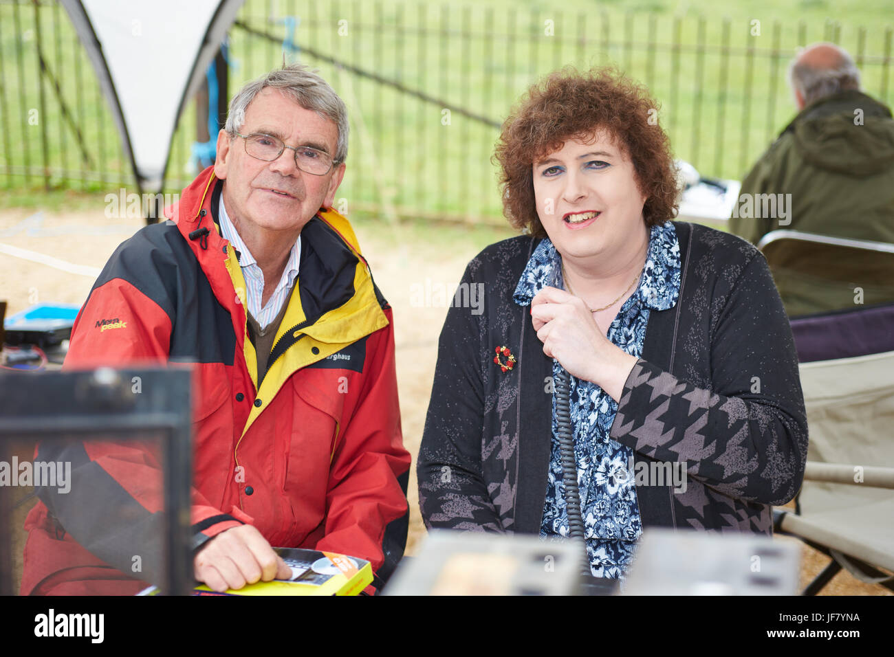 Organisers of the Ride and Stride cycle event Harry Hogg (L) and Dr Alison Johnston (R) pose with old radios outside - Stock Image