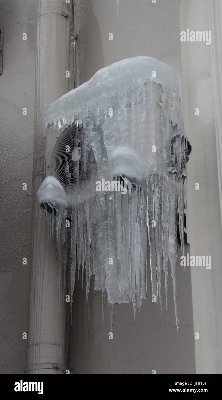 Air conditioning frozen over as an icicle - Stock Image