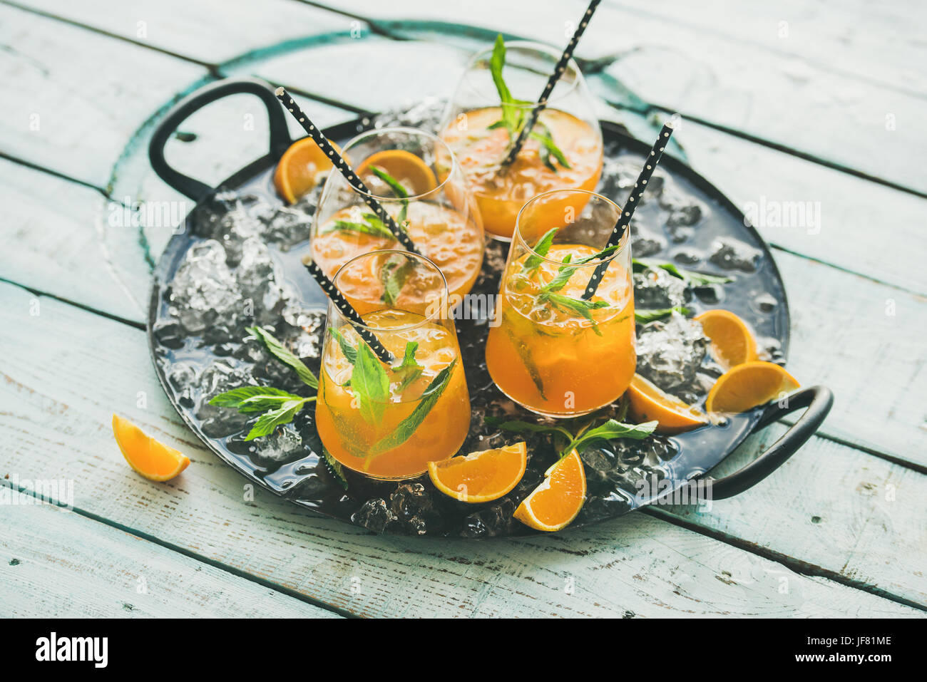Refreshing alcoholic summer cocktail in glasses on tray - Stock Image