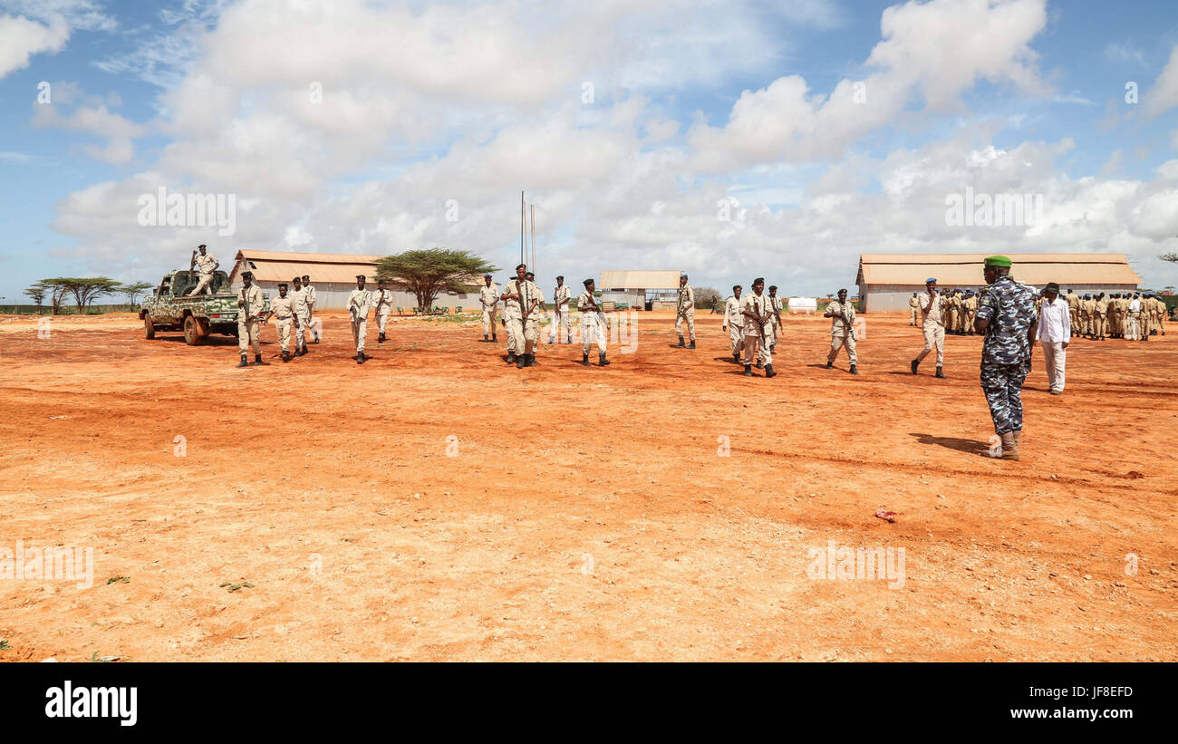 Police trainees demonstrate skills acquired during a close protection course conducted by the African Union Mission Stock Photo