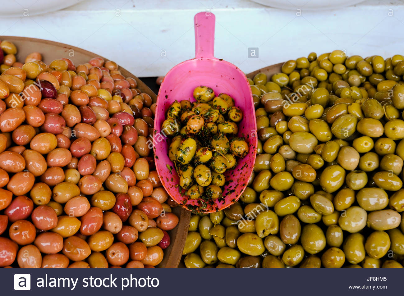 Bowls of cured olives for sale at the Medina souk. - Stock Image