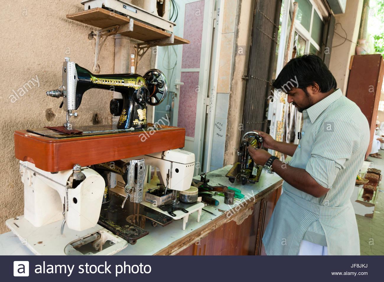 A sewing machine repairman at work at the souk in Nizwa. Stock Photo