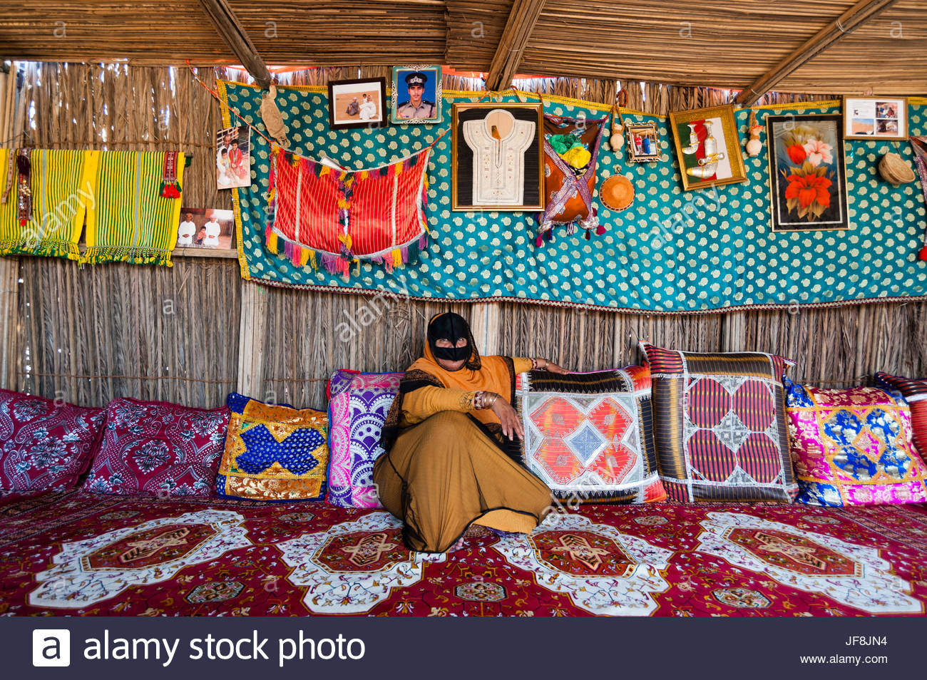 Portrait of a Bedouin woman relaxing in her home. - Stock Image
