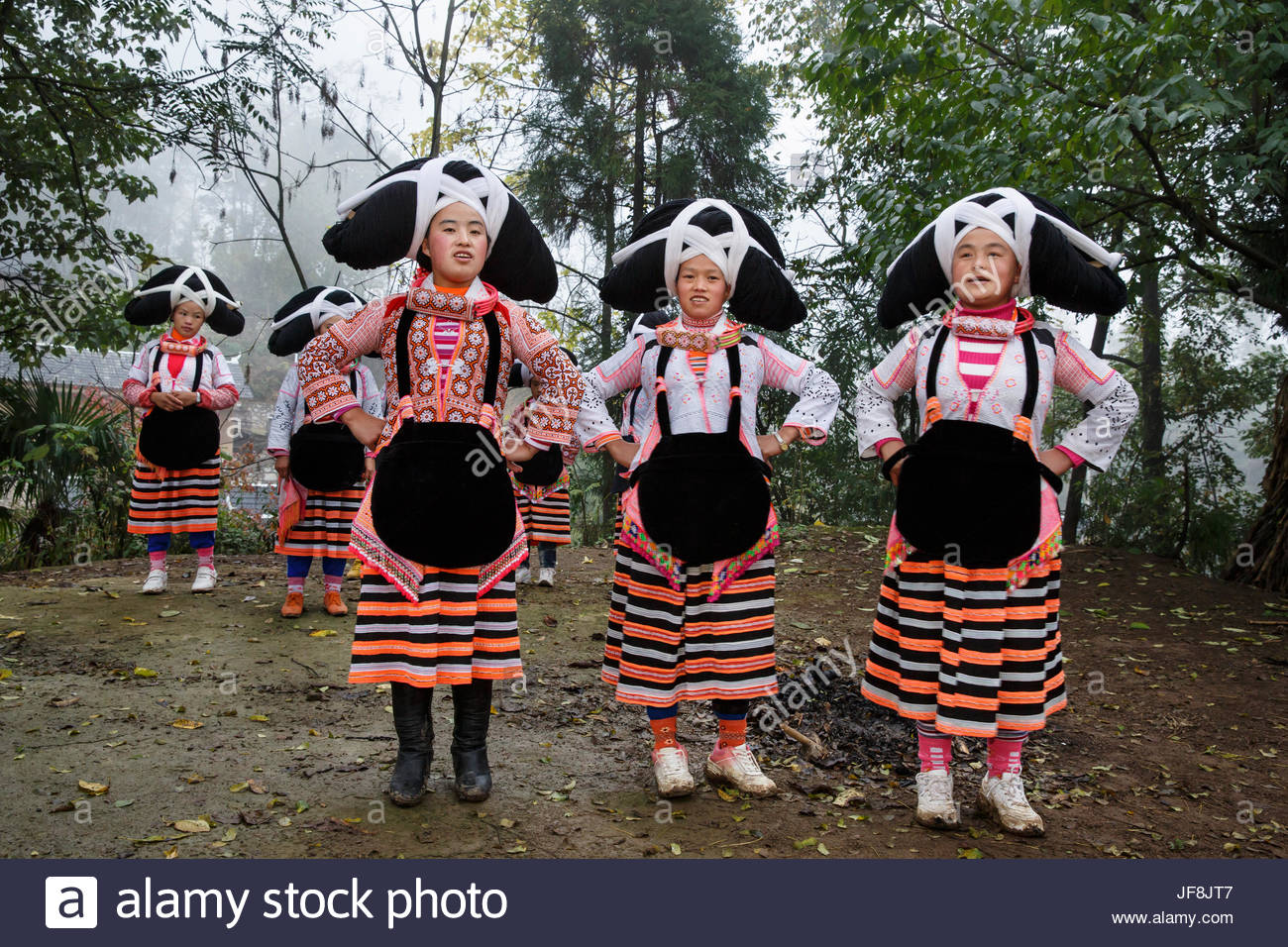 Women from the Long-horned Miao ethnic minority group in Gaoxing village. - Stock Image