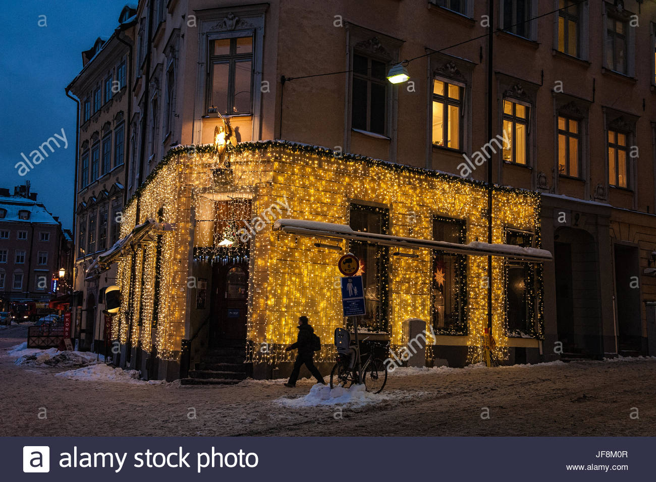 A building illuminated with Christmas lights. - Stock Image
