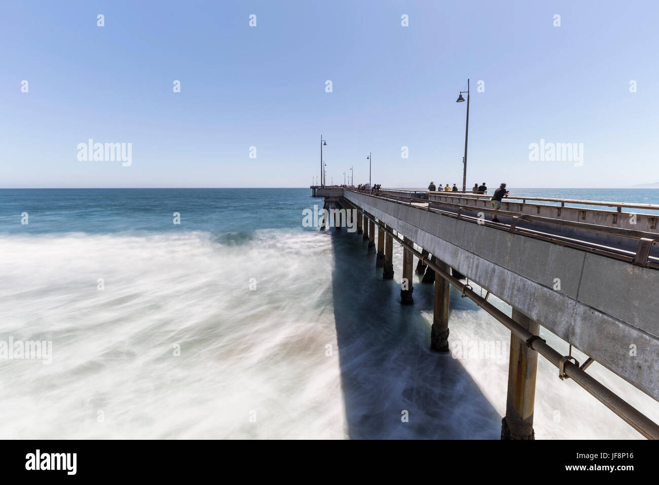 Los Angeles, California, USA - June 26, 2017:  Venice beach fishing pier with motion blur waves. - Stock Image