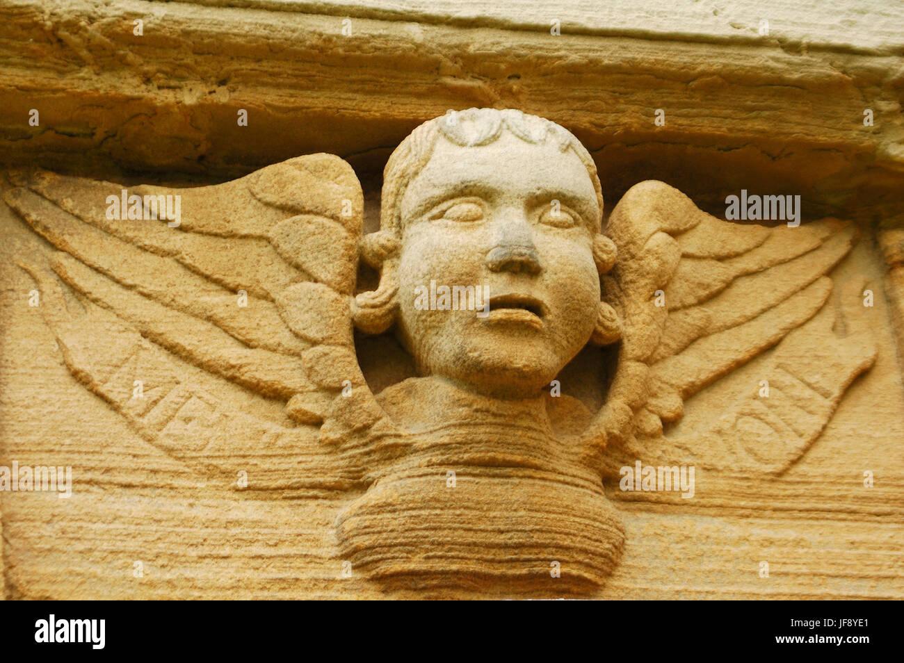 closeup of old 'in memorium' sandstone sculpture - Stock Image
