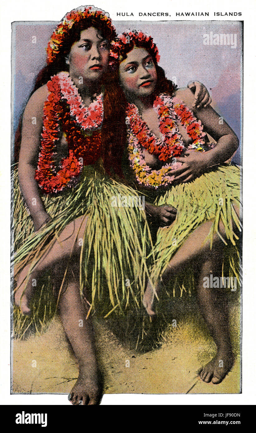 Hula dancers wearing grass skirts and floral lei, Hawaii - Stock Image