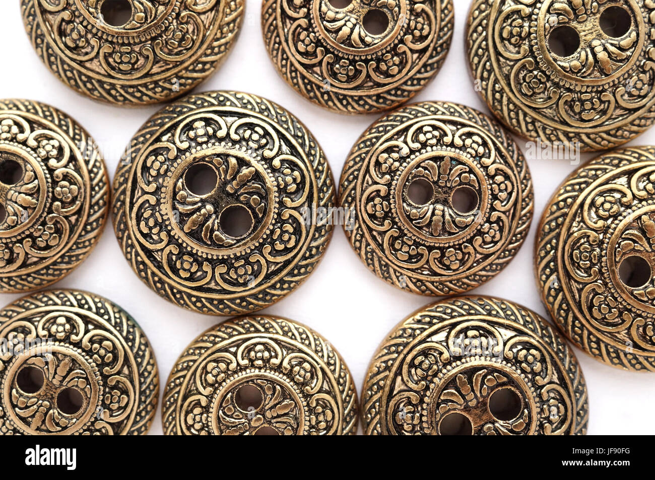 Bronze buttons with baroque pattern, two sizes mix - Stock Image