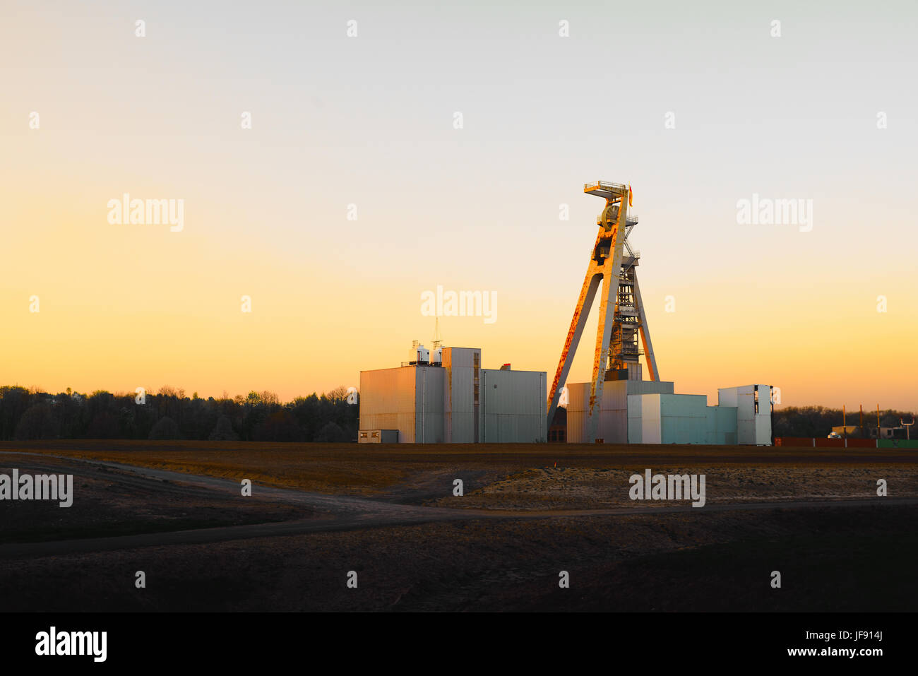 Old coal mining complex in Germany during sunset - Stock Image
