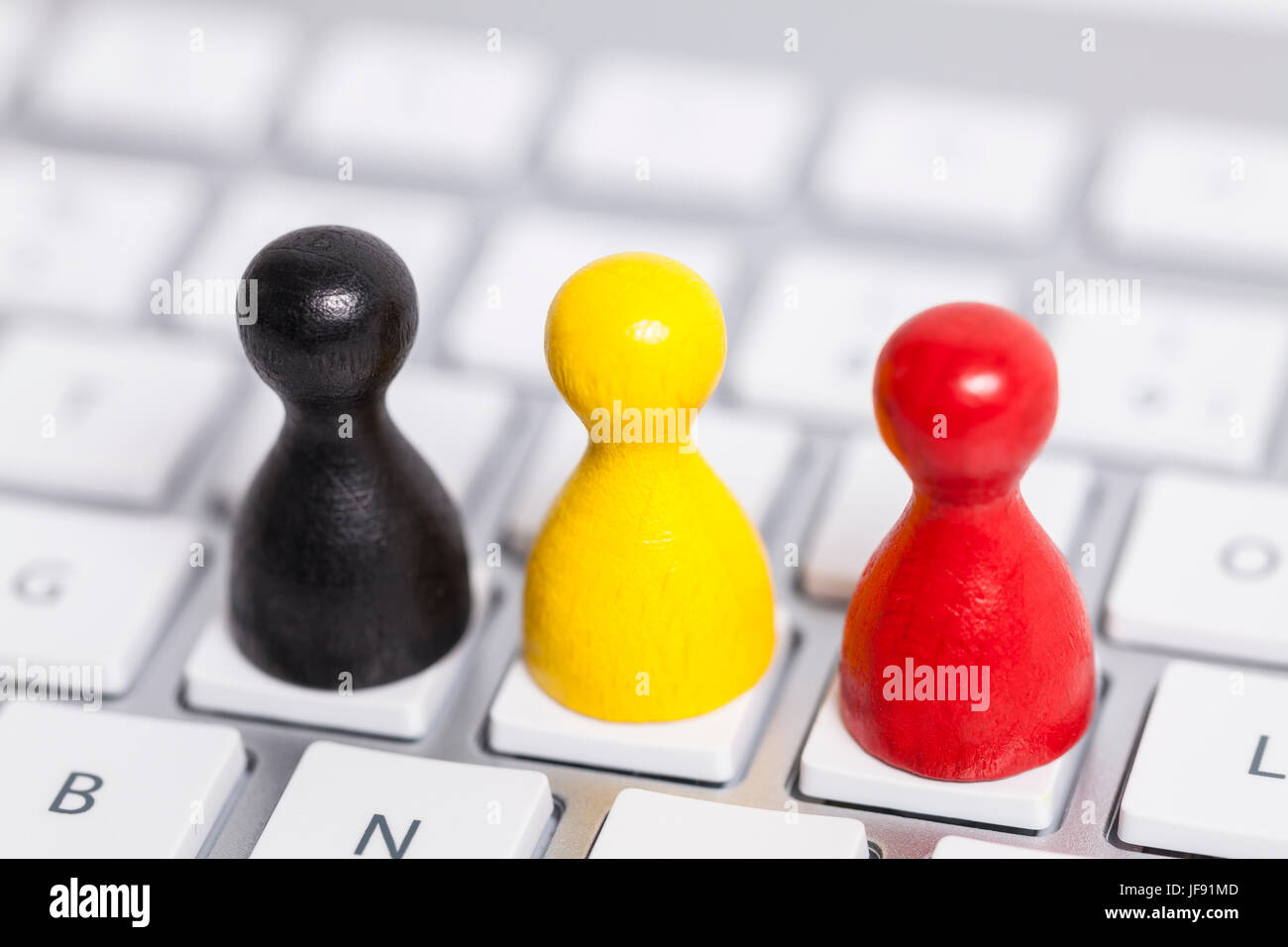 German flag figures on keyboard - Stock Image