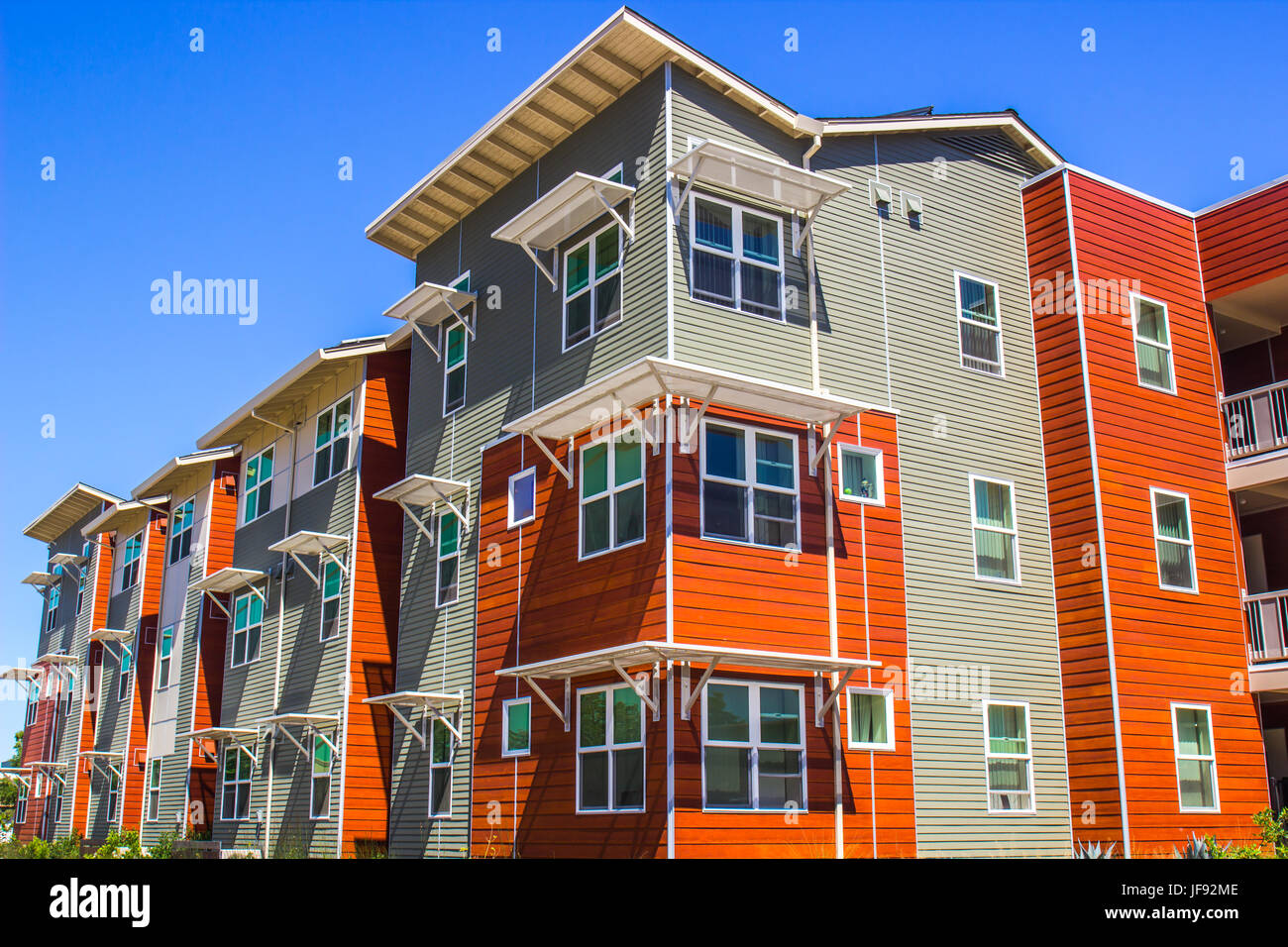 Multi Colored Three Story Building - Stock Image