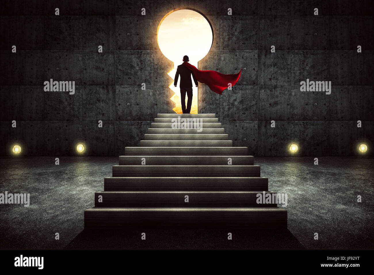 Businessman in a suit and cape stand on stair against concrete wall with exit door ,sunrise scene city skyline outdoor - Stock Image