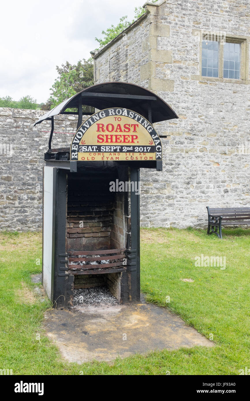 Revolving Roasting Jack in the historic village of Eyam in the Derbyshire Peak District where a sheep is spit roast - Stock Image