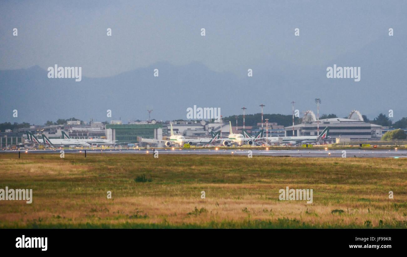 Milan, Italy - June 29th, 2017: Alitalia commercial airplane taxis at Milan's Linate Airport in Italy during - Stock Image