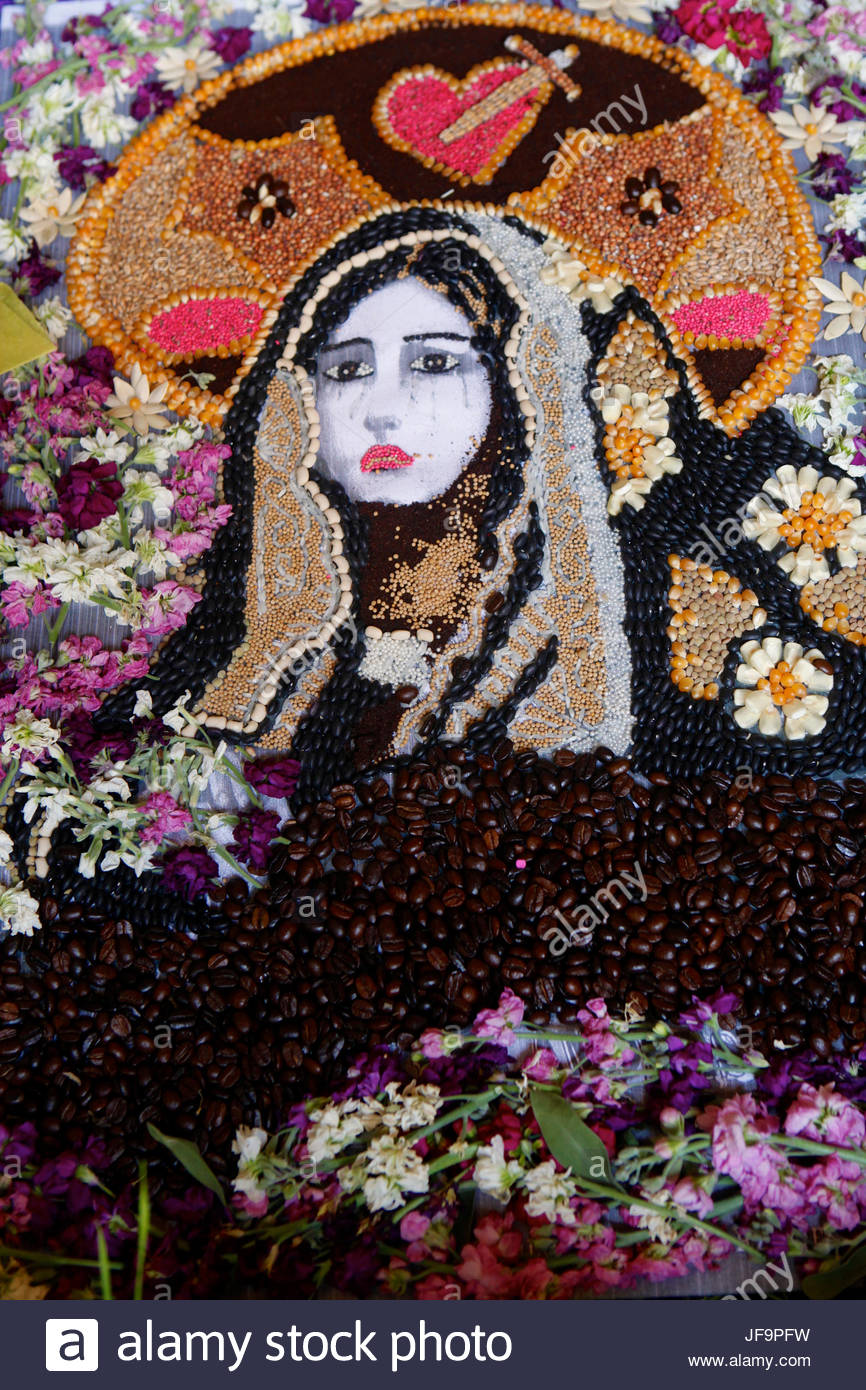Decorative artwork made of rice, beans and flowers. - Stock Image