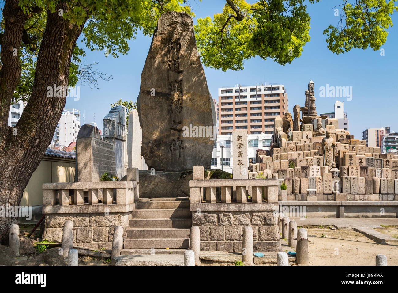 A cemetery and pillar tombstones at the Sensoji Temple in Osaka, Japan, Asia. - Stock Image