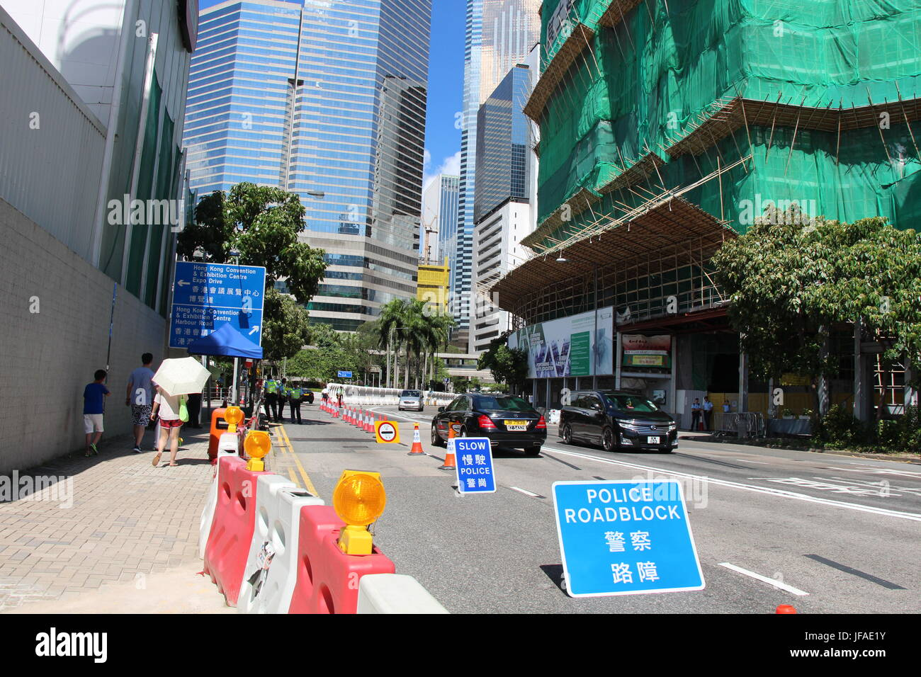 On the first day of Xi Jinping's visit to Hong Kong, pedestrians on the left were swiftly told by police not - Stock Image