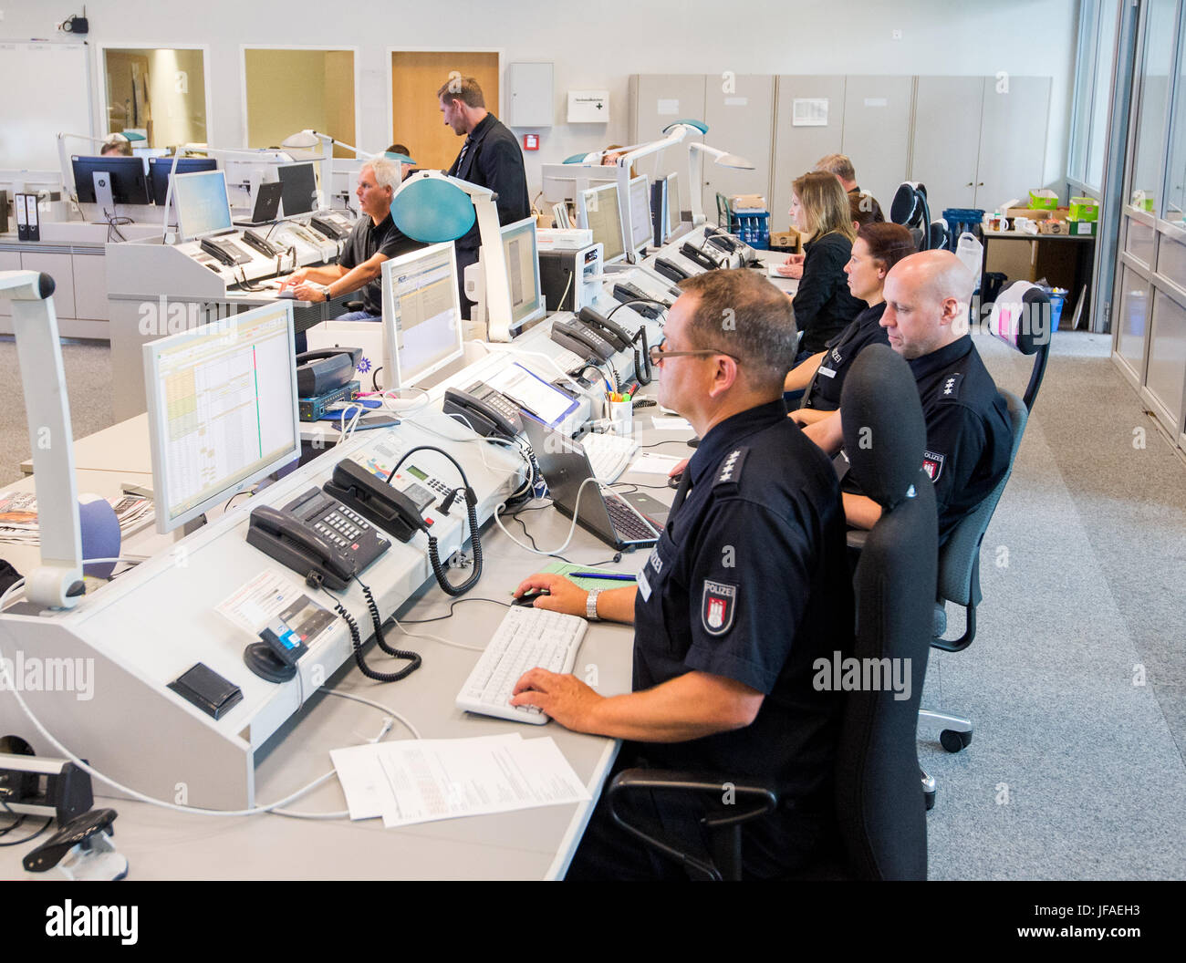Hamburg, Germany. 30th June, 2017. Officers of the police sit at the G20 command center in Hamburg, Germany, 30 - Stock Image