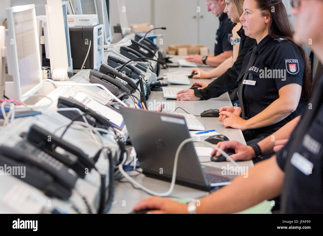 Hamburg, Germany. 30th June, 2017. dpatop - Officers of the police sit at the G20 command center in Hamburg, Germany, - Stock Image