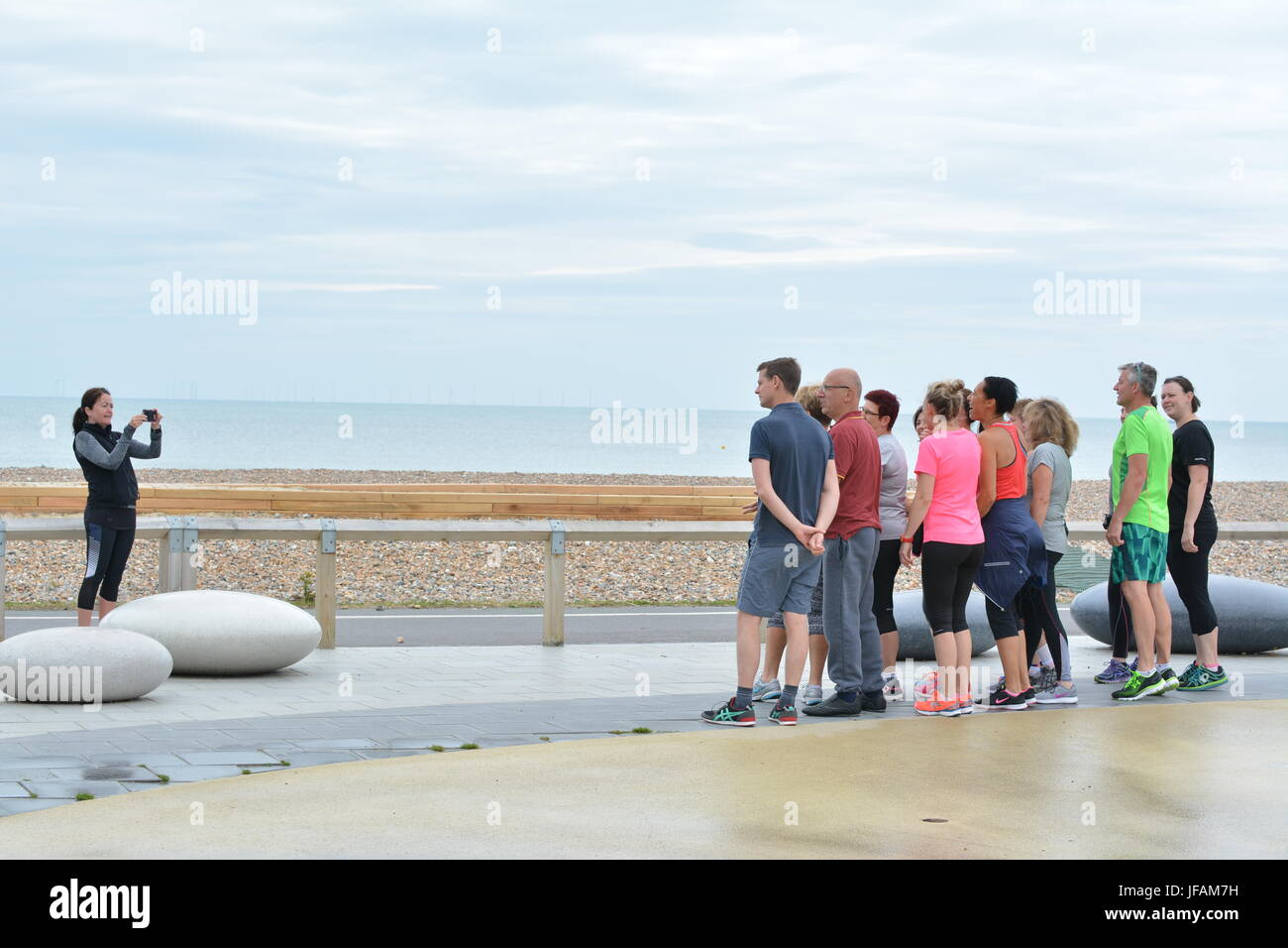 Group of people having a group photo taken. - Stock Image