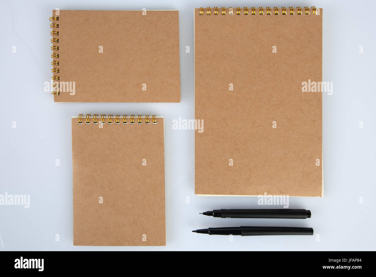Set of notepads with black pens for mockups. Top view with copy space Stock Photo
