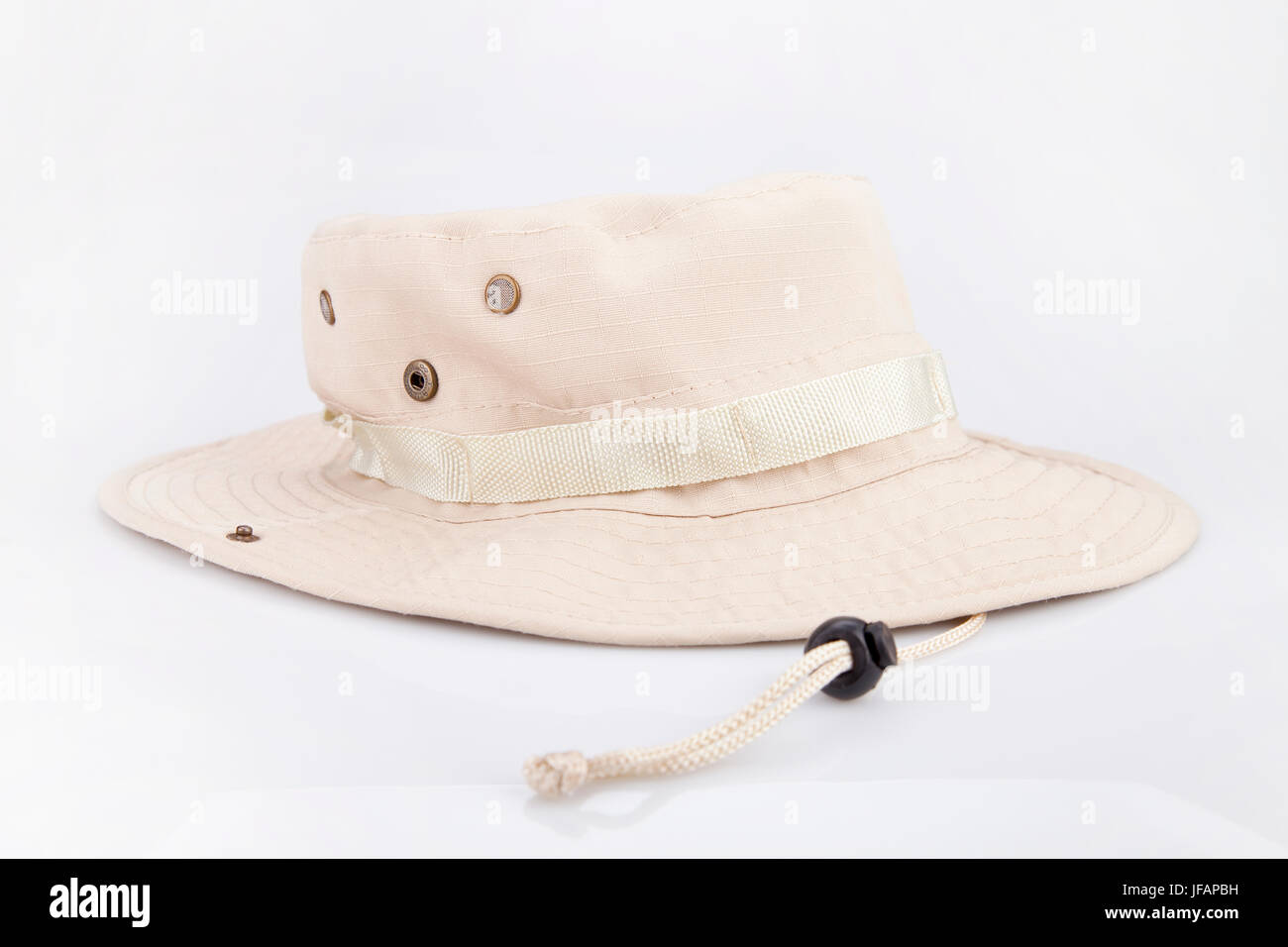 26b5a4bf3 Beige adventure hat on a white surface. Safari hat isolated on white ...