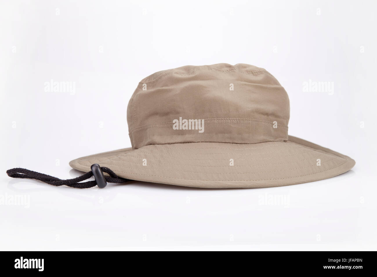 865606ffa Khaki adventure hat on a white surface. Safari hat isolated on white ...