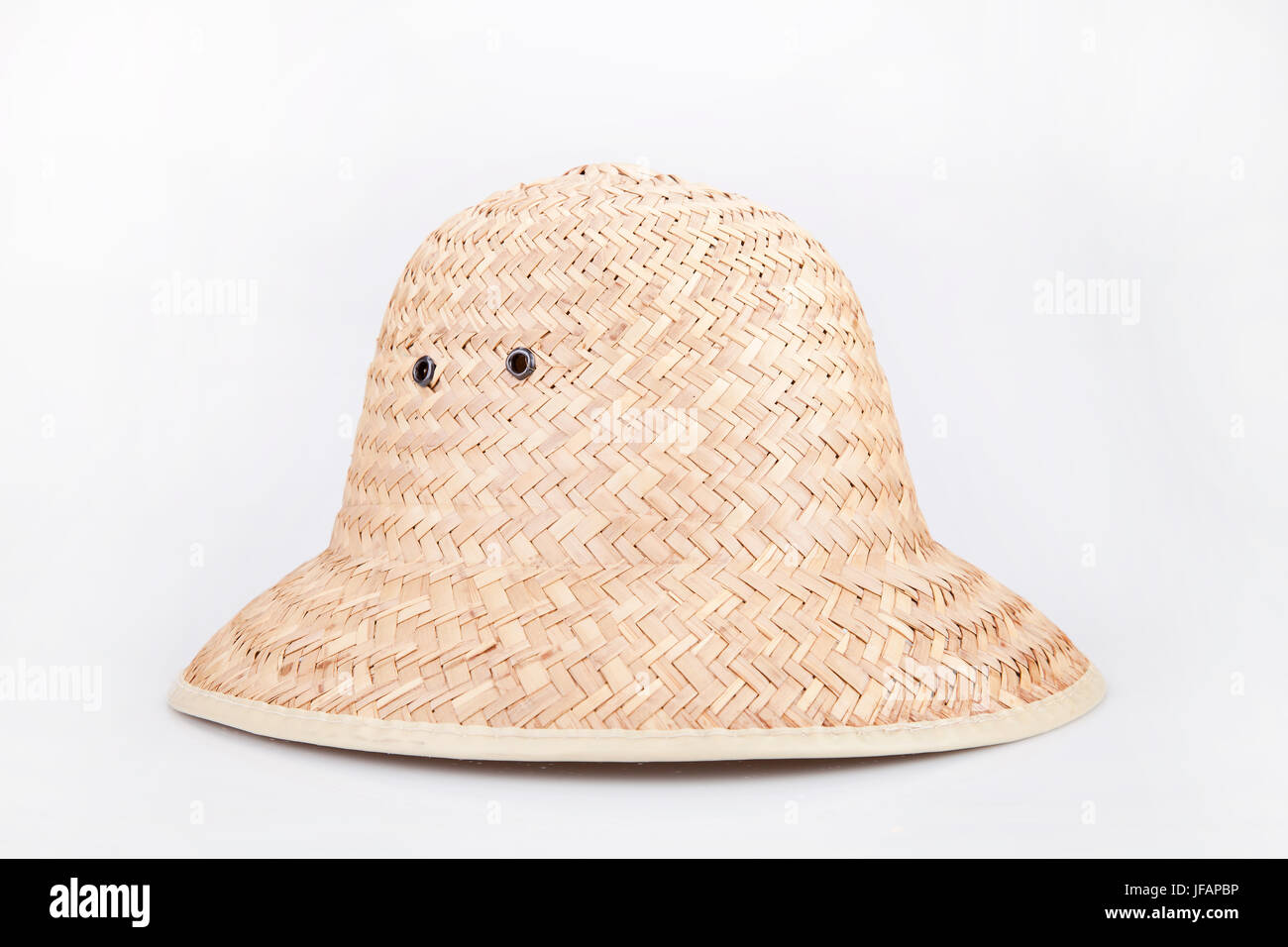 469942d9b6c Straw hat on a white surface. Wicker hat isolated on white background. -  Stock