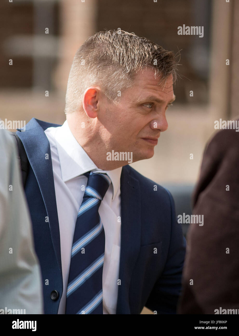PC Keith Burgess arrives at Guildford Crown Court in Guildford, to be sentenced for misconduct in public office. Stock Photo